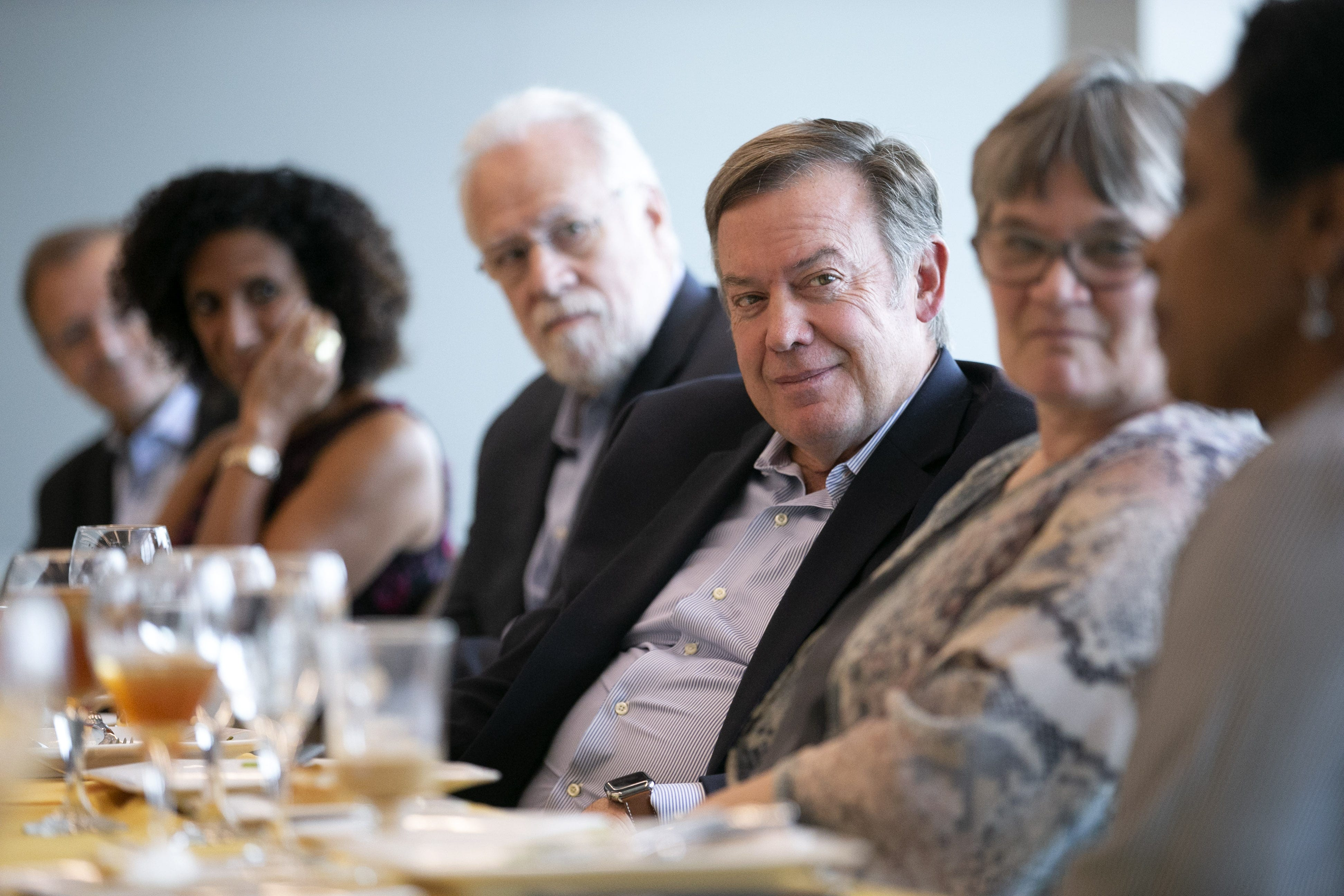 ASU President Michael Crow (center) listens during luncheon for new ASU faculty on the ASU Tempe campus on Oct. 16, 2018.