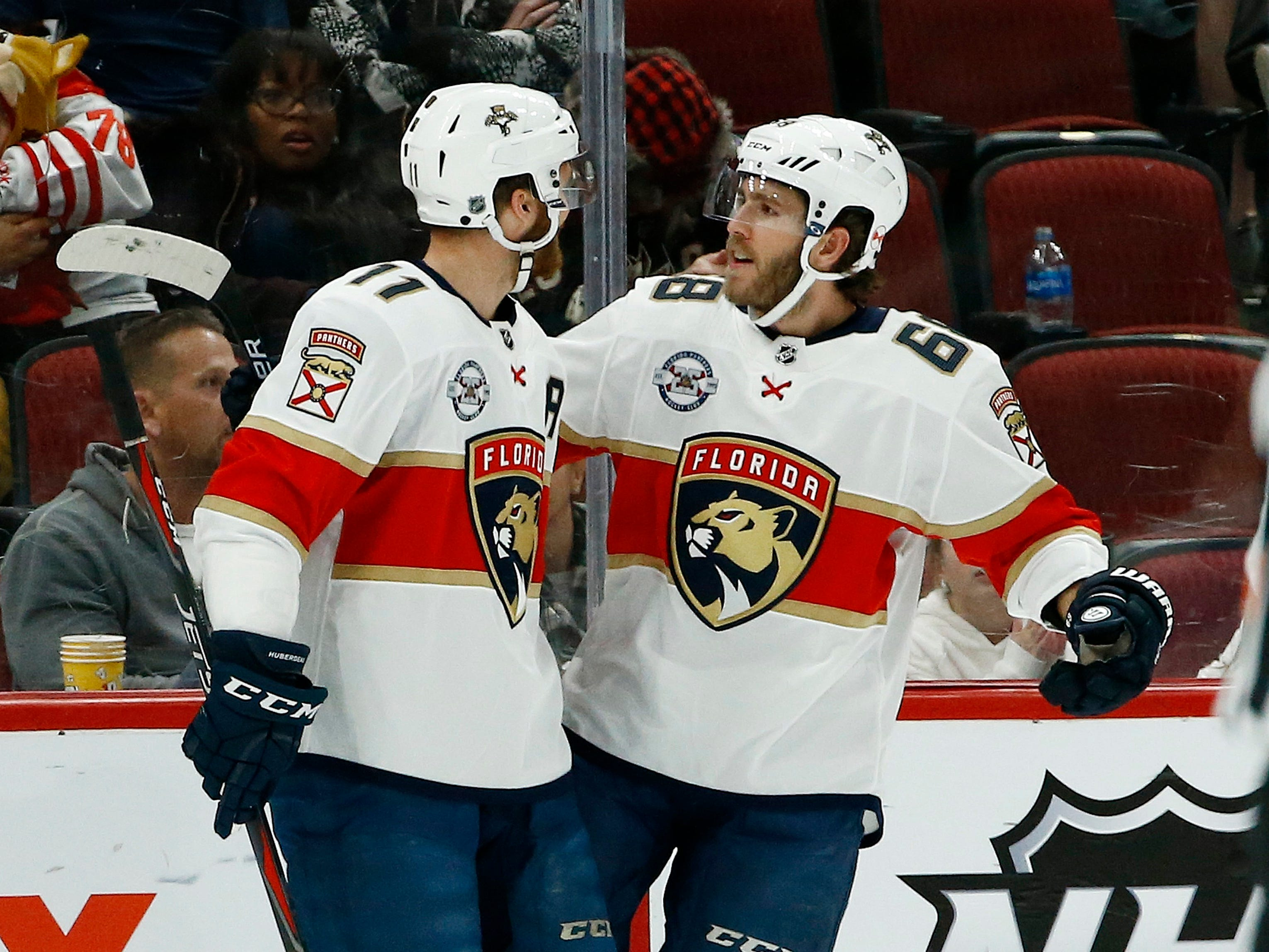 Florida Panthers left wing Mike Hoffman (68) celebrates his goal against the Arizona Coyotes with Jonathan Huberdeau (11) during the second period of an NHL hockey game Tuesday, Feb. 26, 2019, in Glendale, Ariz.