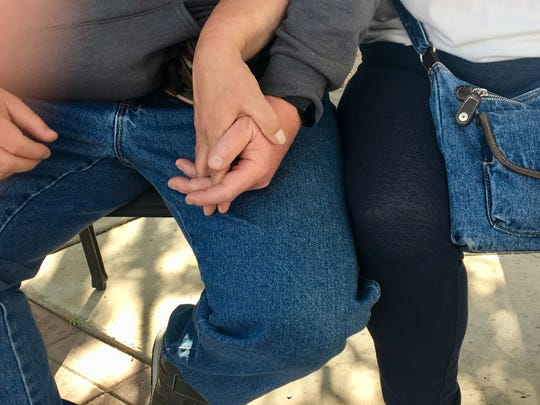 Jon Barker wobbled a bit when he stood, his balance off after suffering a stroke.  The first day she met him, Cheryl Pawloski took his hand to steady him. They've been holding hands ever since.