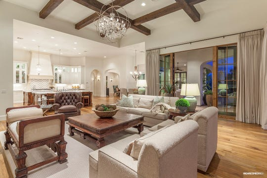 Thad and Maryellyn Miller paid cash for this this mansion in Paradise Valley for $3.89M.