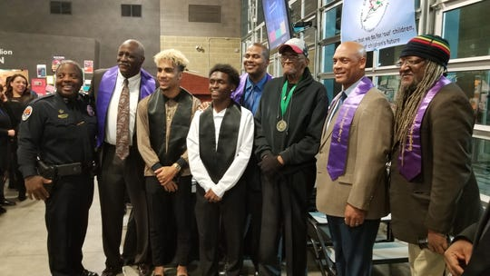 Past and current honorees gather near the stage on Friday, Feb. 22 during the Chandler Men of Action African American Banquet.