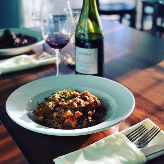 The concise menu at Farish House in downtown Phoenix includes cassoulet made with white beans, pork, sausage and duck gravy.