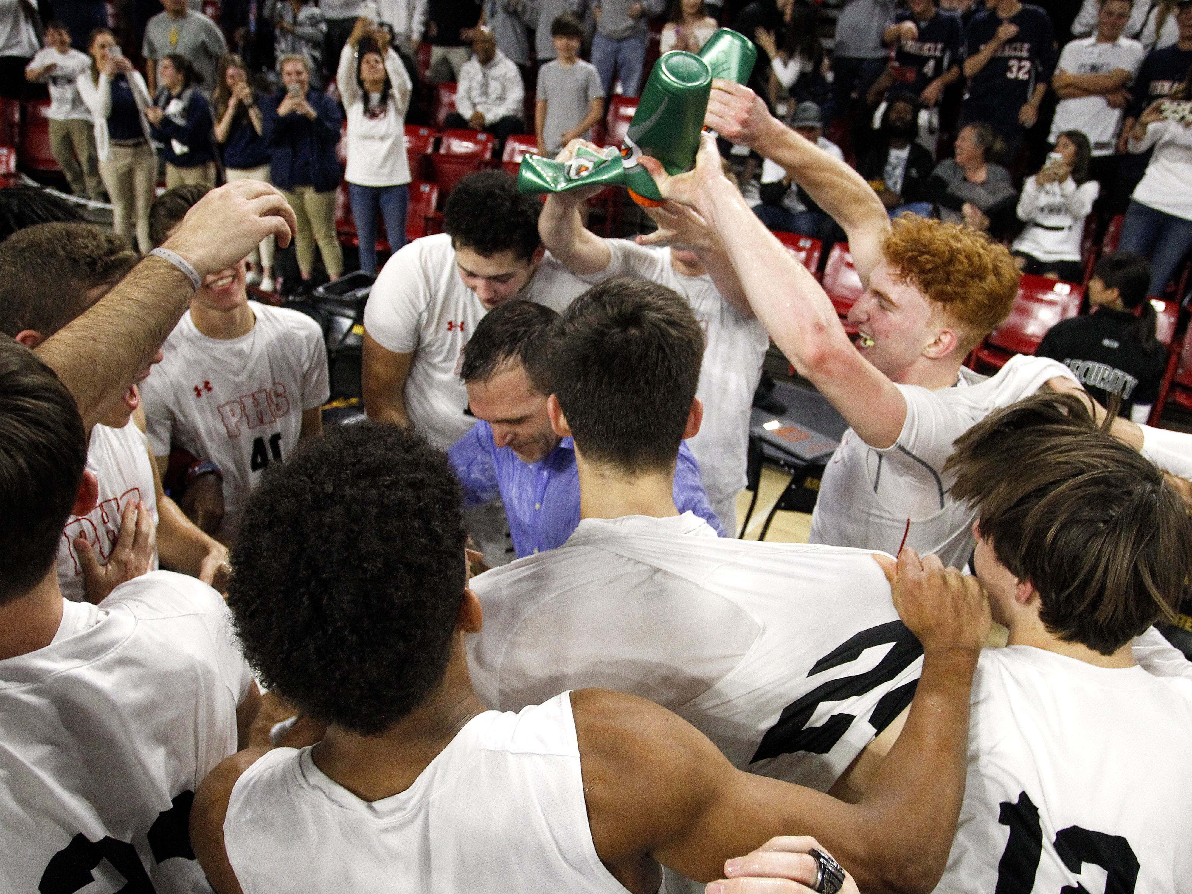Pinnacle players douse their coachÊCharles Wilde with a water after their 83-64 win over Chaparral in the 6A Boys State Championship at Wells Fargo Arena in Tempe Tuesday, Feb 26, 2019.