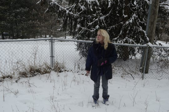 Renee Anderson stands in the yard of her Goodells home weeks after the murder of her son Kevin Anderson on Feb. 10.