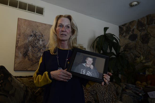 Renee Anderson holds a photo of her son Kevin Anderson, who was shot to death on Feb. 10.