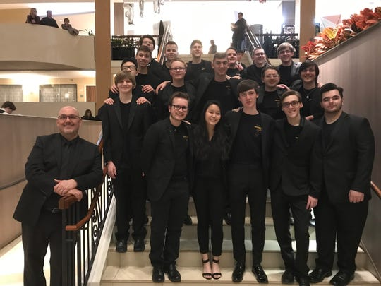Members of Arlington High School's Jazz Machine are shown with director Richard Guillen at the Mid-Atlantic Jazz Festival.