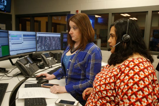 Sheriff's aides, from left Helen Sample and Leslie Lugo work in the dispatch center inside the Dutchess Law Enforcement Center on February 26, 2019.
