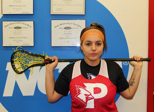 New Paltz native Alexis Garcia poses after practice on Tuesday as a member of the SUNY Plattsburgh women's lacrosse team.
