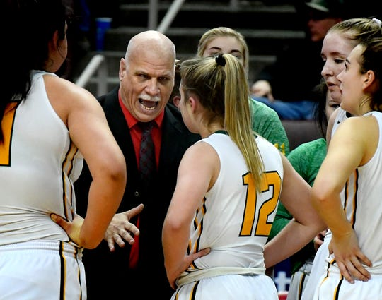 York Catholic girls' basketball head coach Kevin Bankos talks to his team last season. Under a proposed bill, Bankos' team would no longer compete against public schools during the state playoffs.
