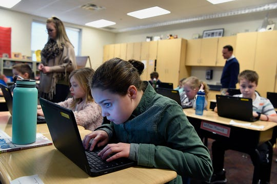 Larry J. Macaluso Elementary School third grade student Joise Shoffner types essay answers using the interactive classroom tool Nearpod environmental studies, Wednesday, February 26, 2019.