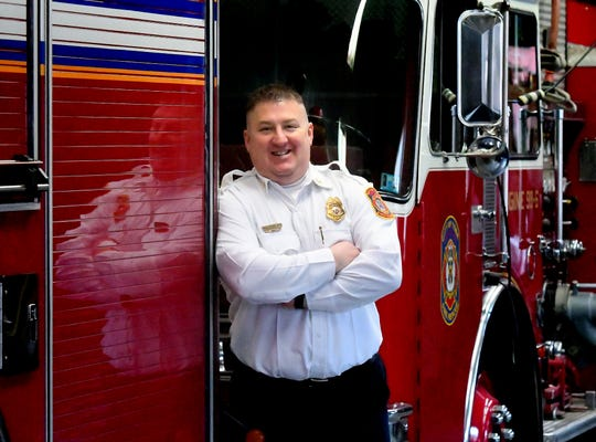 York City Fire Department Chad Deardorff poses with equipment at Rex/Laurel Fire Station on South Duke Street Wednesday, Feb. 27, 2019. The station is the oldest continually operating station in the country. He is replacing Dave Michaels who retired recently after serving as chief since 2012. Bill Kalina photo