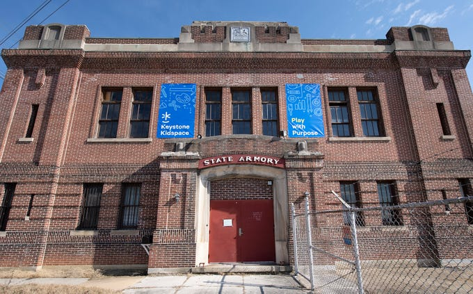 Banners were added to the facade Wednesday February 27, 2019. The York Armory, a brick fortress built in 1913 once used by the Pa. National Guard, will soon be transformed into Keystone Kidspace, an educational experience for families. It's expected to open in 2020.