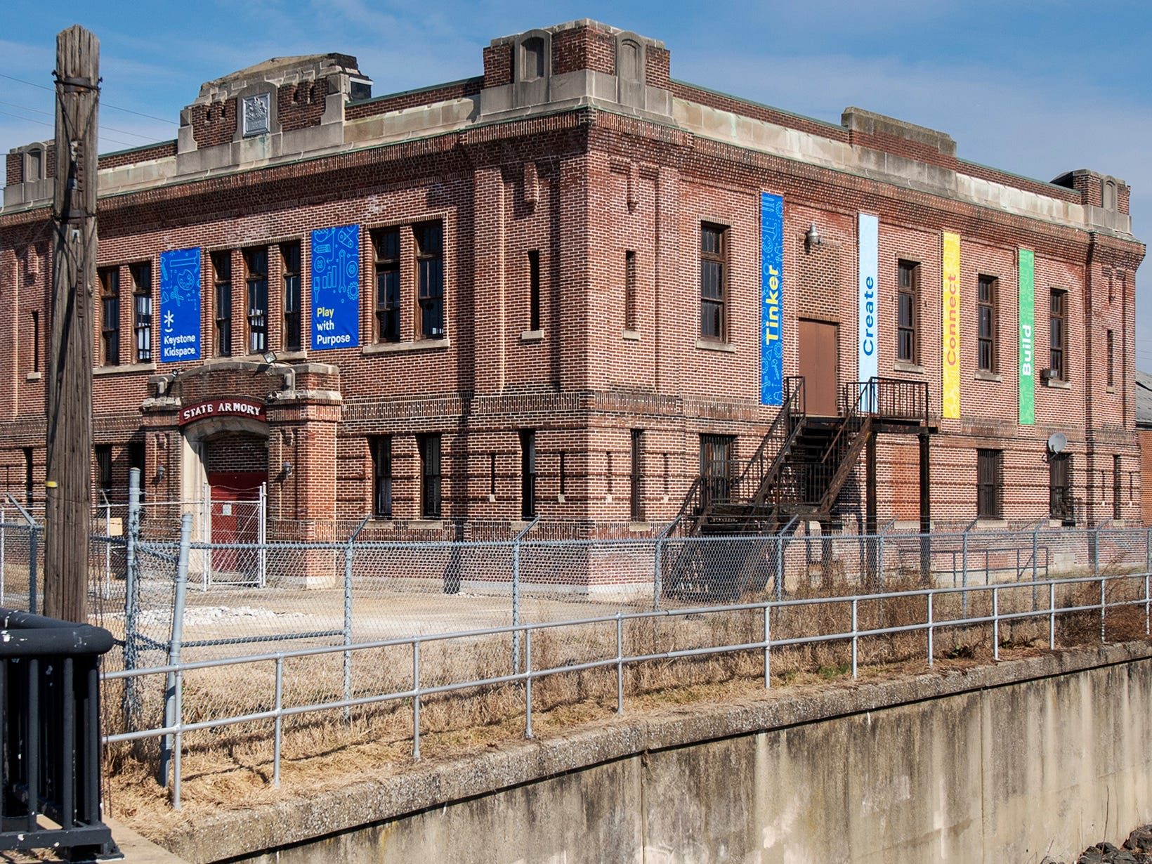Banners were added to the facade Wednesday at the future Keystone Kidspace, which will be built inside the former York Armory building on North George Street in York.