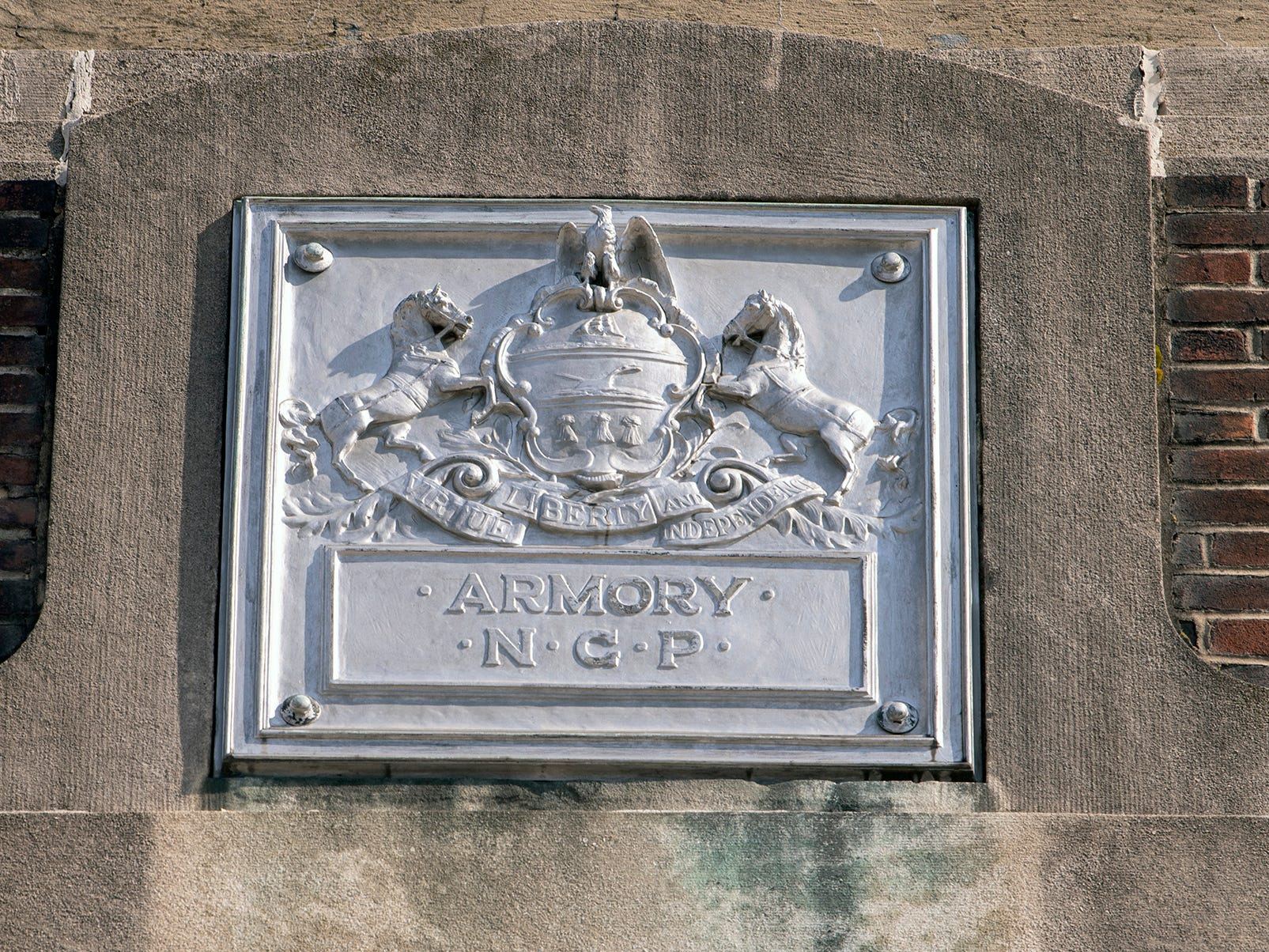 A metal plate is fastened to the facade of the building. The York Armory, a brick fortress built in 1913 once used by the Pa. National Guard, will soon be transformed into Keystone Kidspace, an educational experience for families. It's expected to open in 2020.