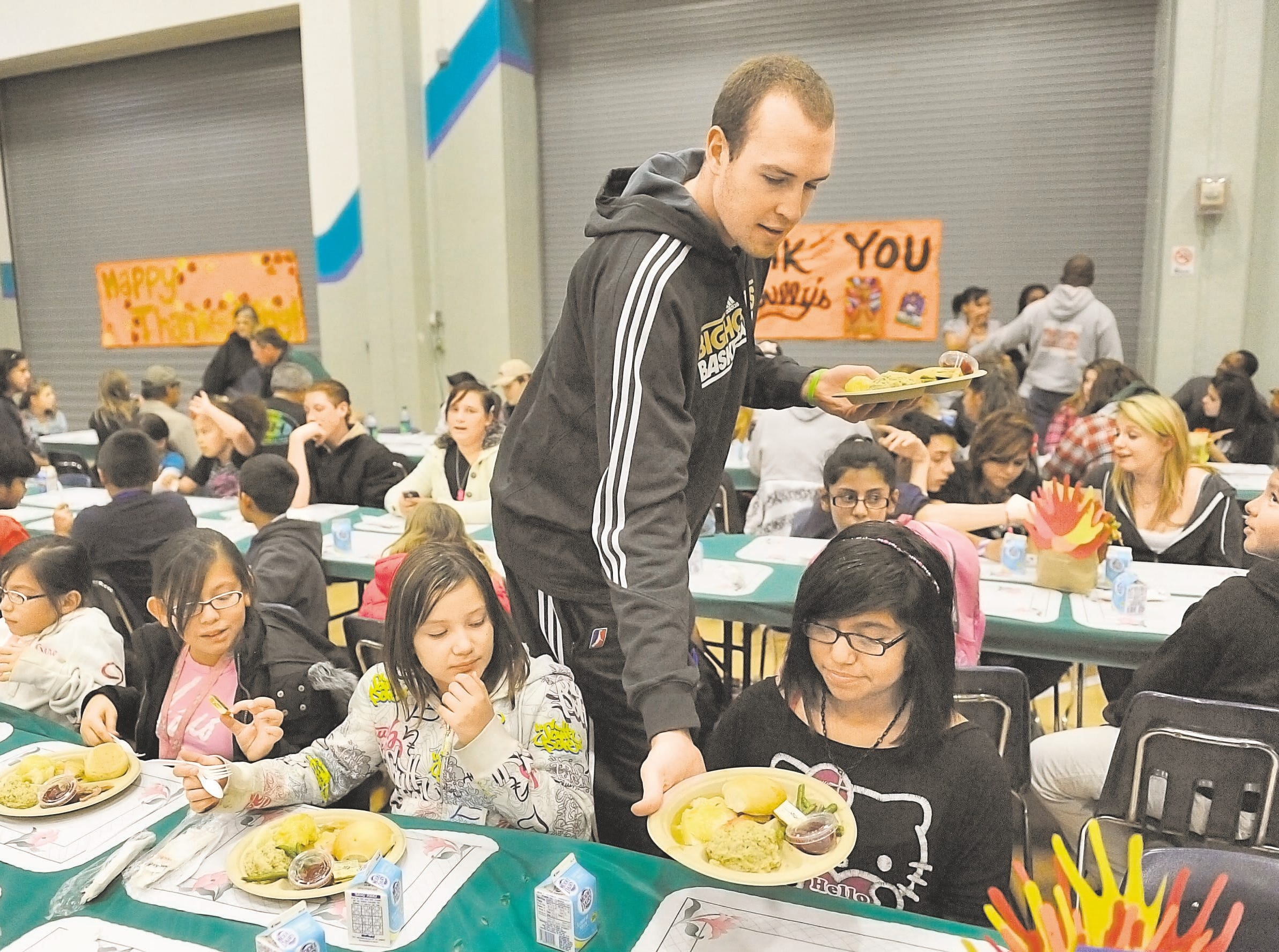 2011: Serving Thanksgiving meals at the Boys & Girls Club.