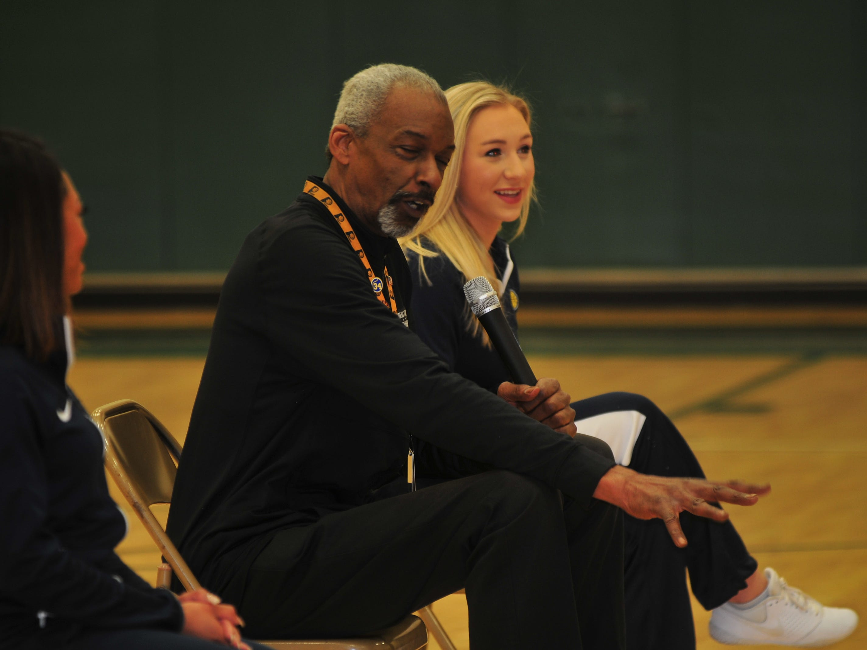 Darnell Hillman, a former Indiana Pacers player, talks about winning an ABA championship with the Pacers as Pacemates Shania (left) and Gwen listen.