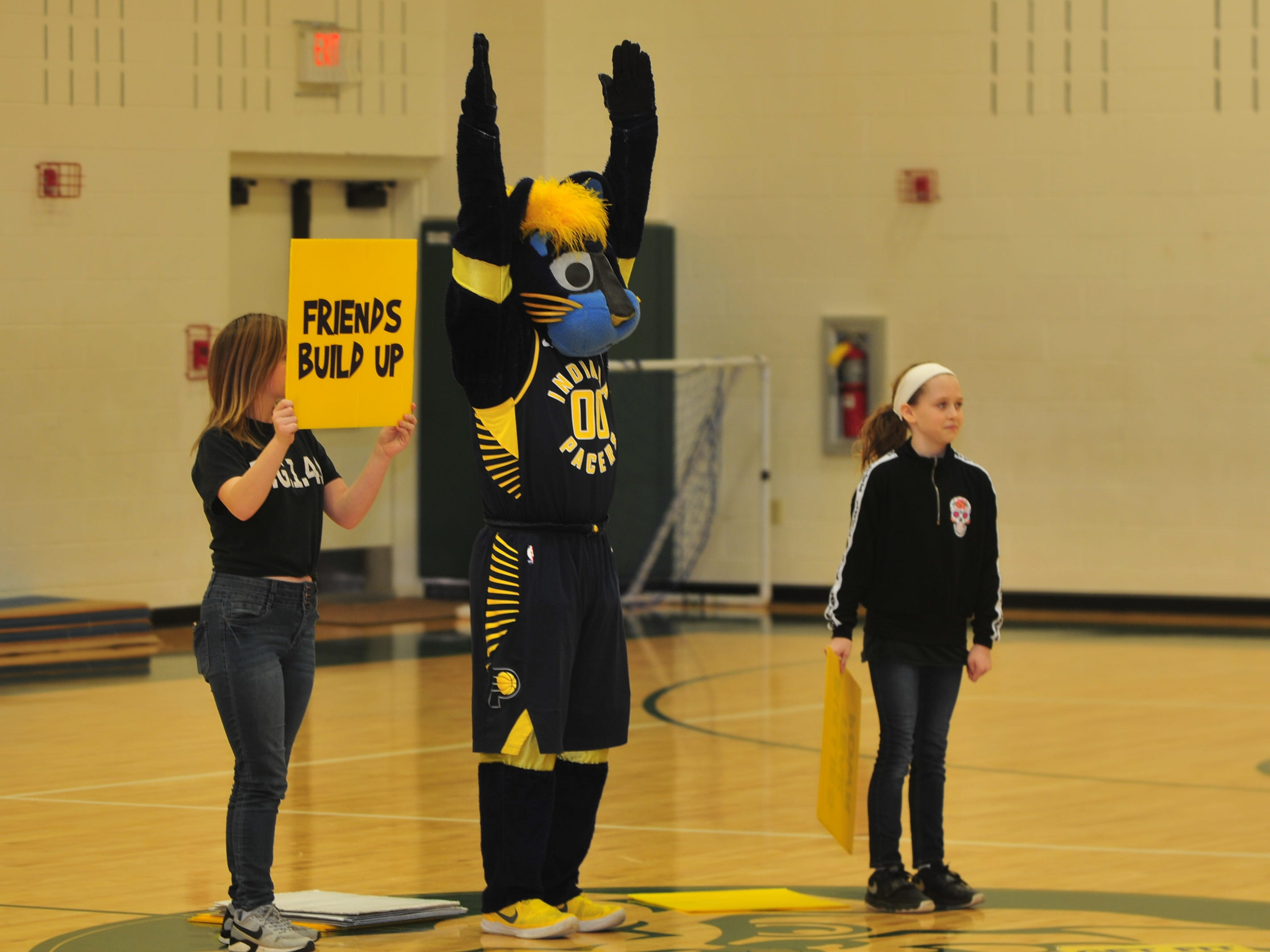 Two volunteers help Boomer make a point Wednesday to Dennis Intermediate School students as he urges them not to bully each other.