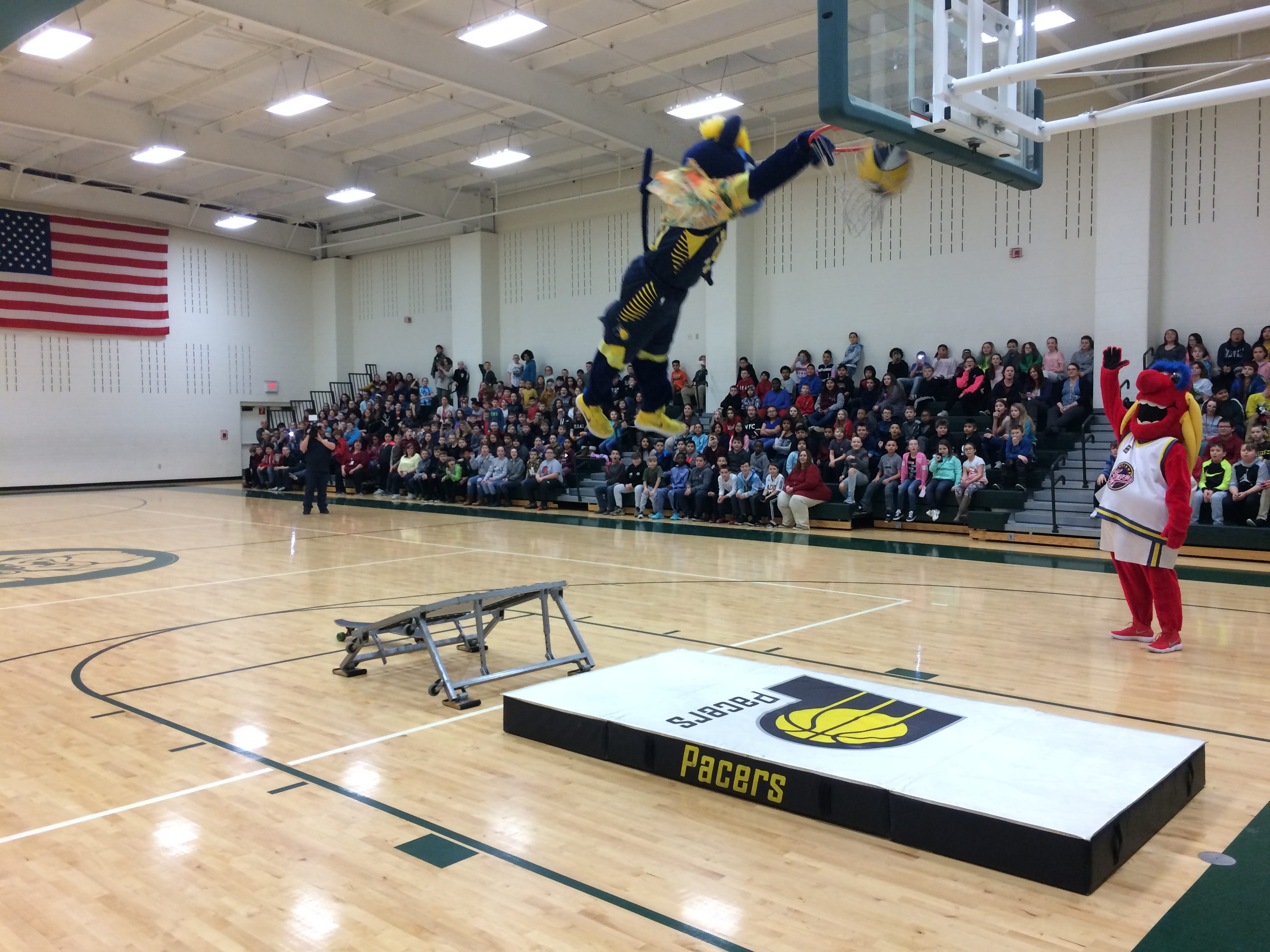 Boomer dunks during Wednesday's program in Dennis Intermediate School.
