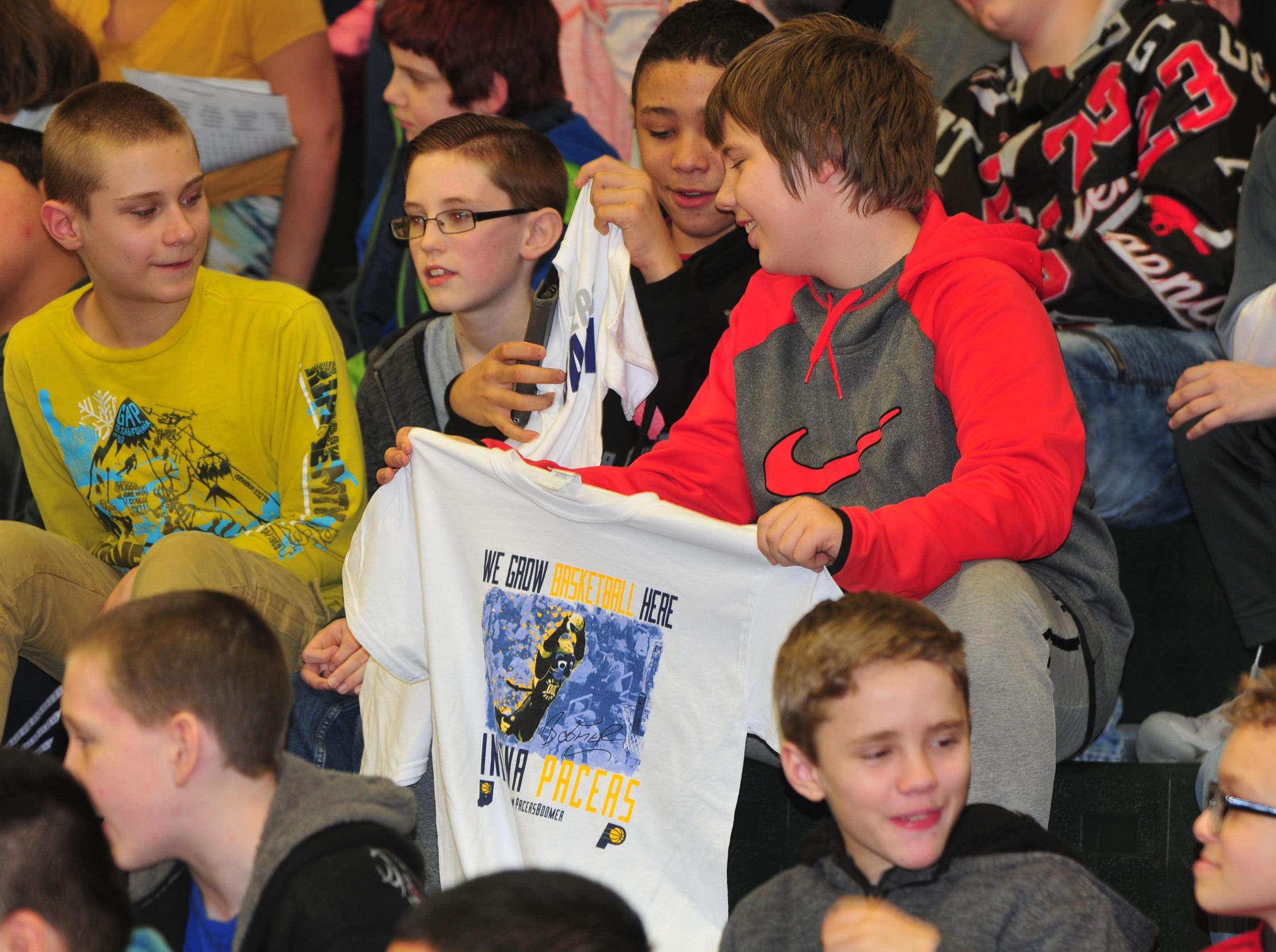 Dennis Intermediate School students check out T-shirts tossed into the stands Wednesday.