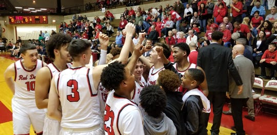 Richmond basketball players get fired up at the start of Tuesday night's sectional game at Tiernan Center.