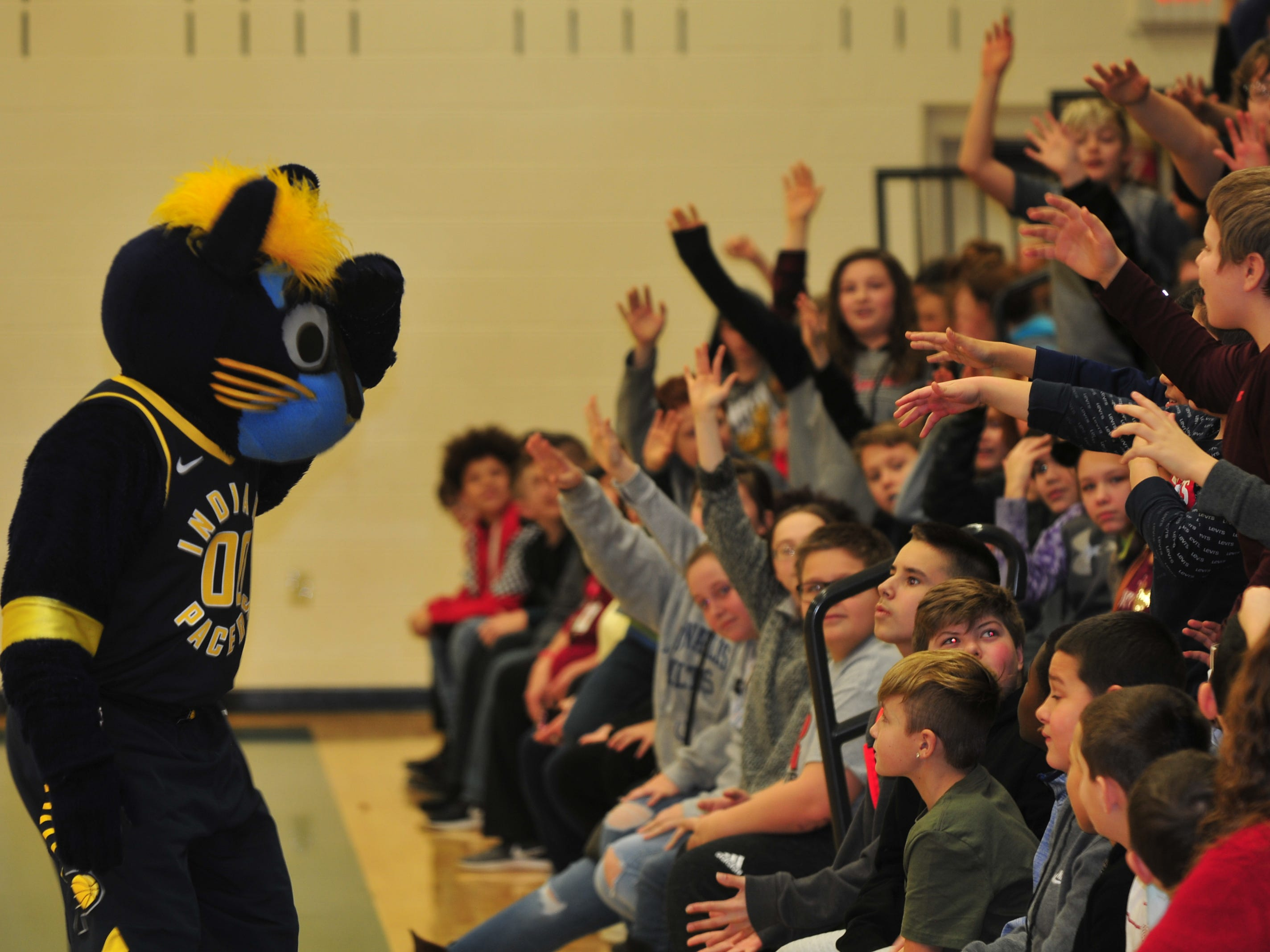 Boomer looks for a volunteer Wednesday during a program at Dennis Intermediate School.