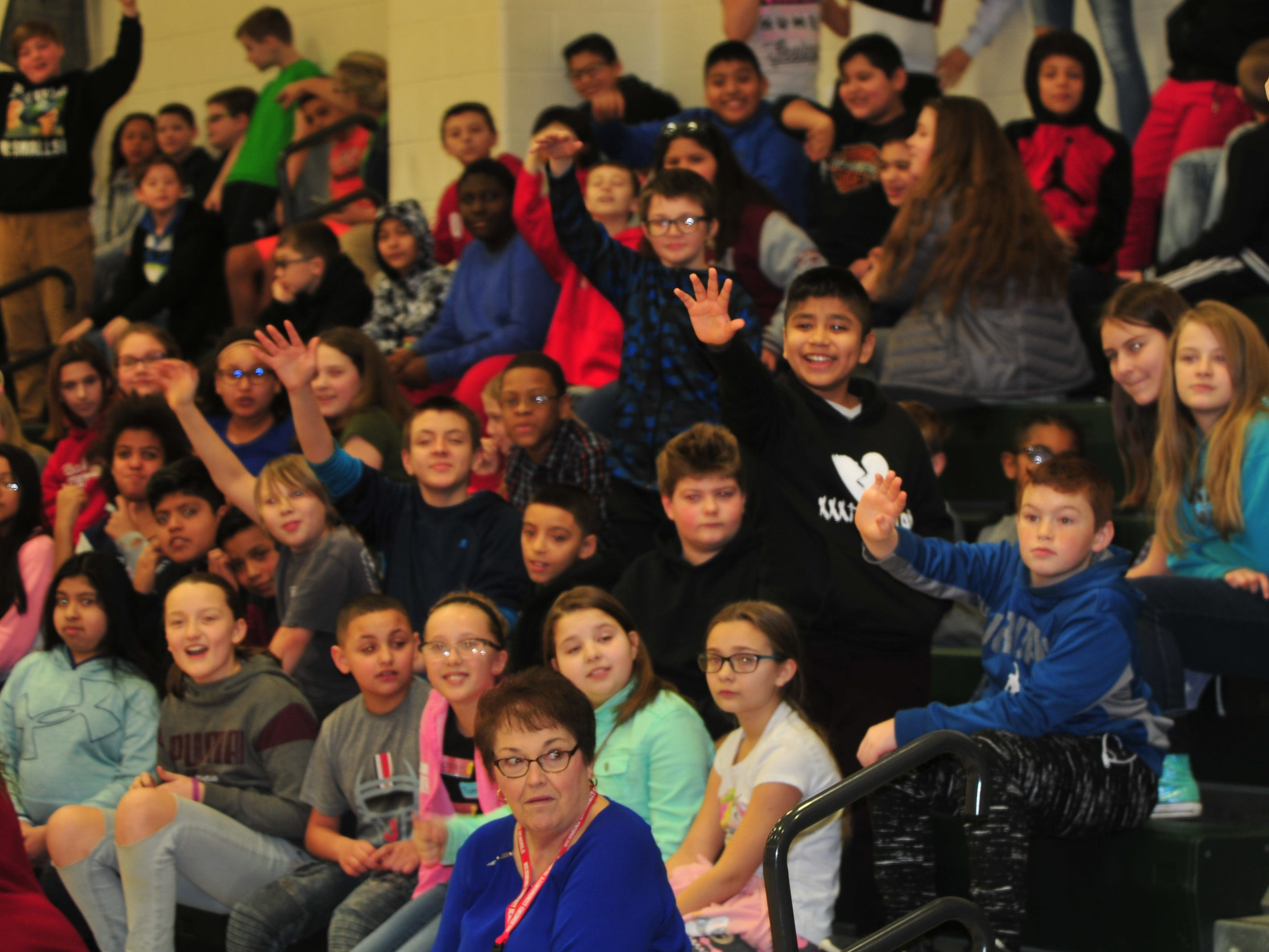 Dennis Intermediate School students attempt to attract Boomer's attention during Wednesday's program.