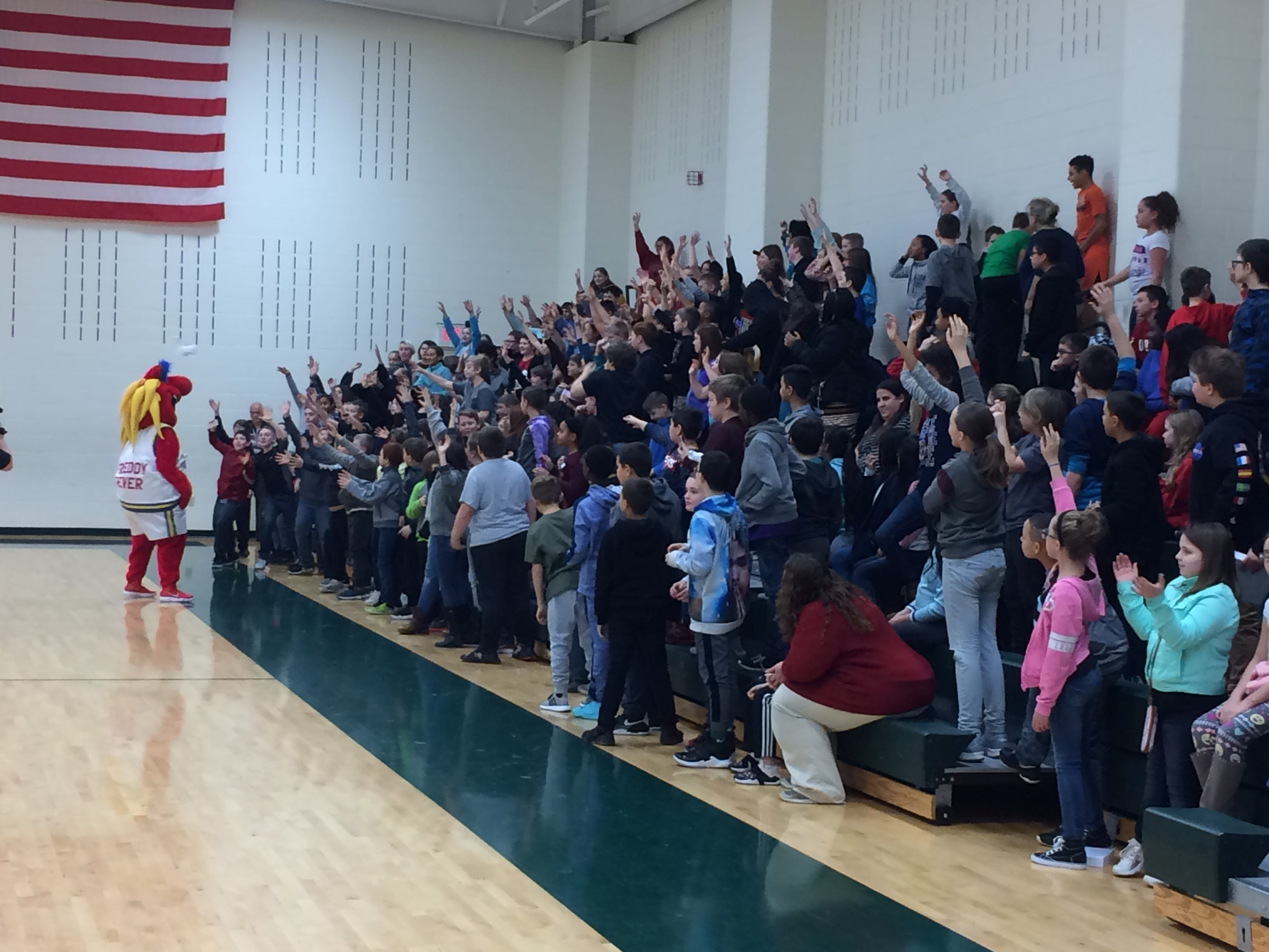Dennis Intermediate School students stand as T-shirts are tossed into their midst Wednesday.