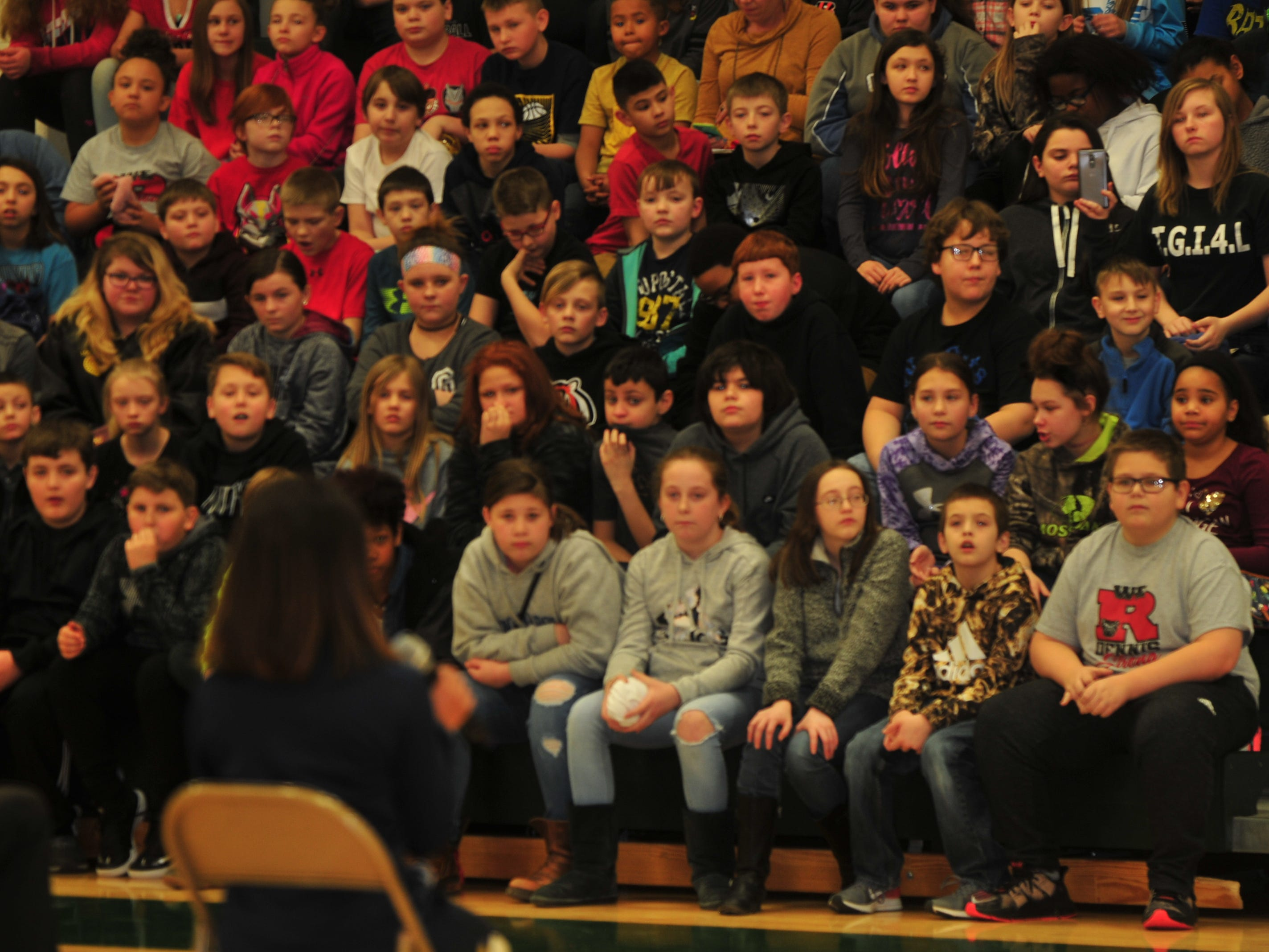 Dennis Intermediate School students listen as Pacemate Shania answers a question Wednesday.