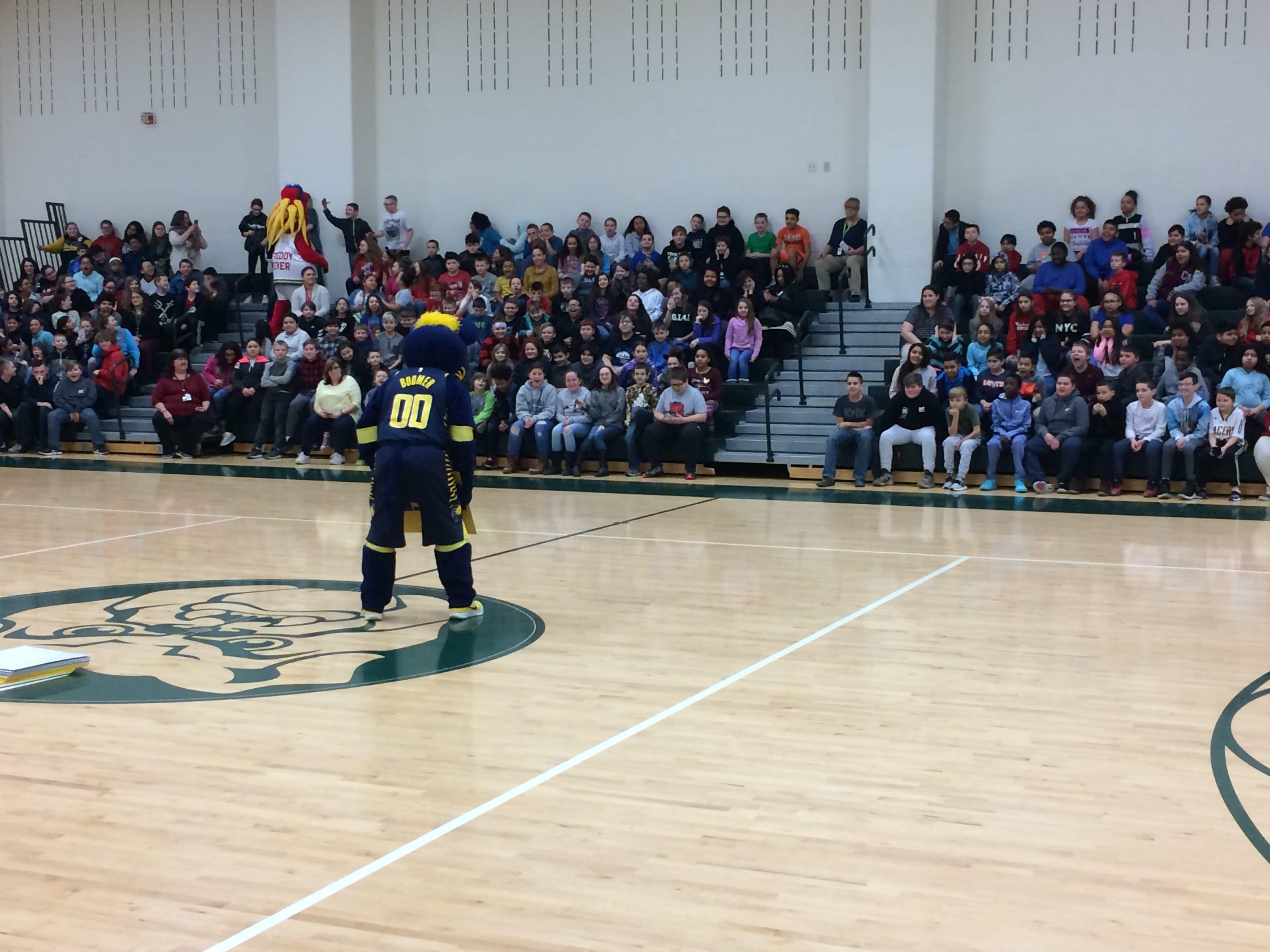 Boomer communicates with signs during a program Wednesday in Dennis Intermediate School.