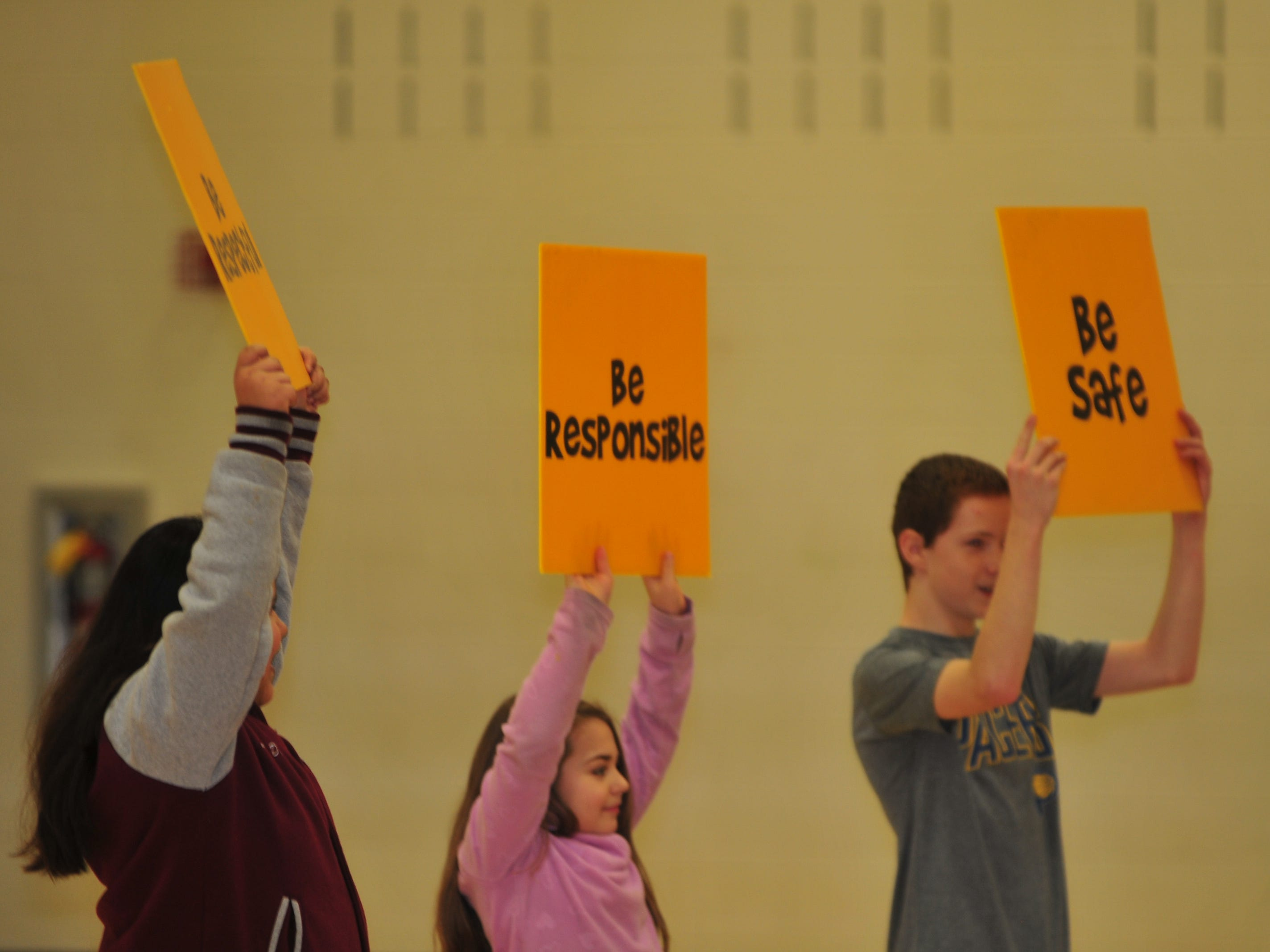 Dennis Intermediate School students help Boomer urge students to be respectful, responsible and safe during Boomer' Wednesday performance.