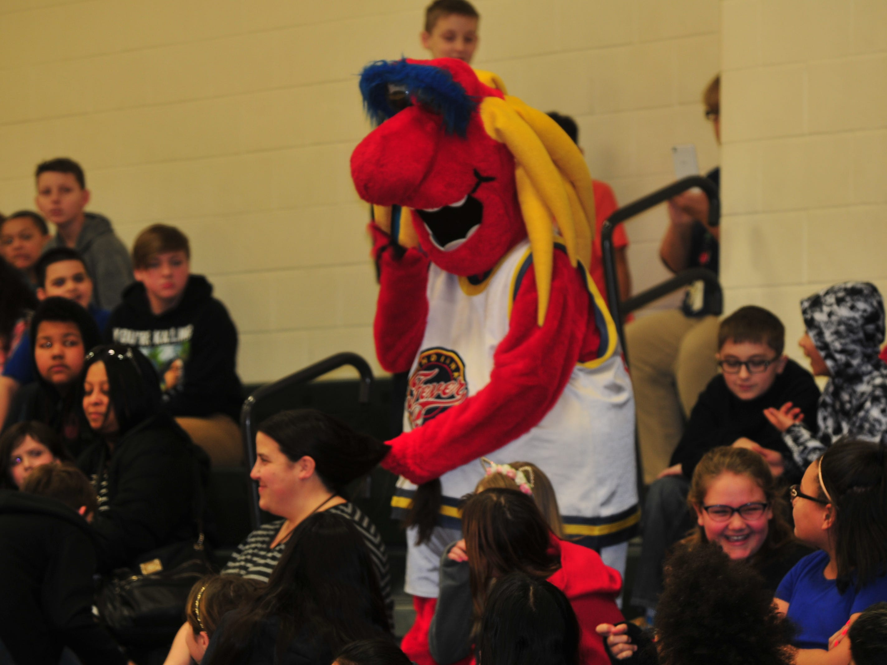 Freddy Fever, mascot for the WNBA's Indiana Fever, appeared Wednesday at Dennis Intermediate School.