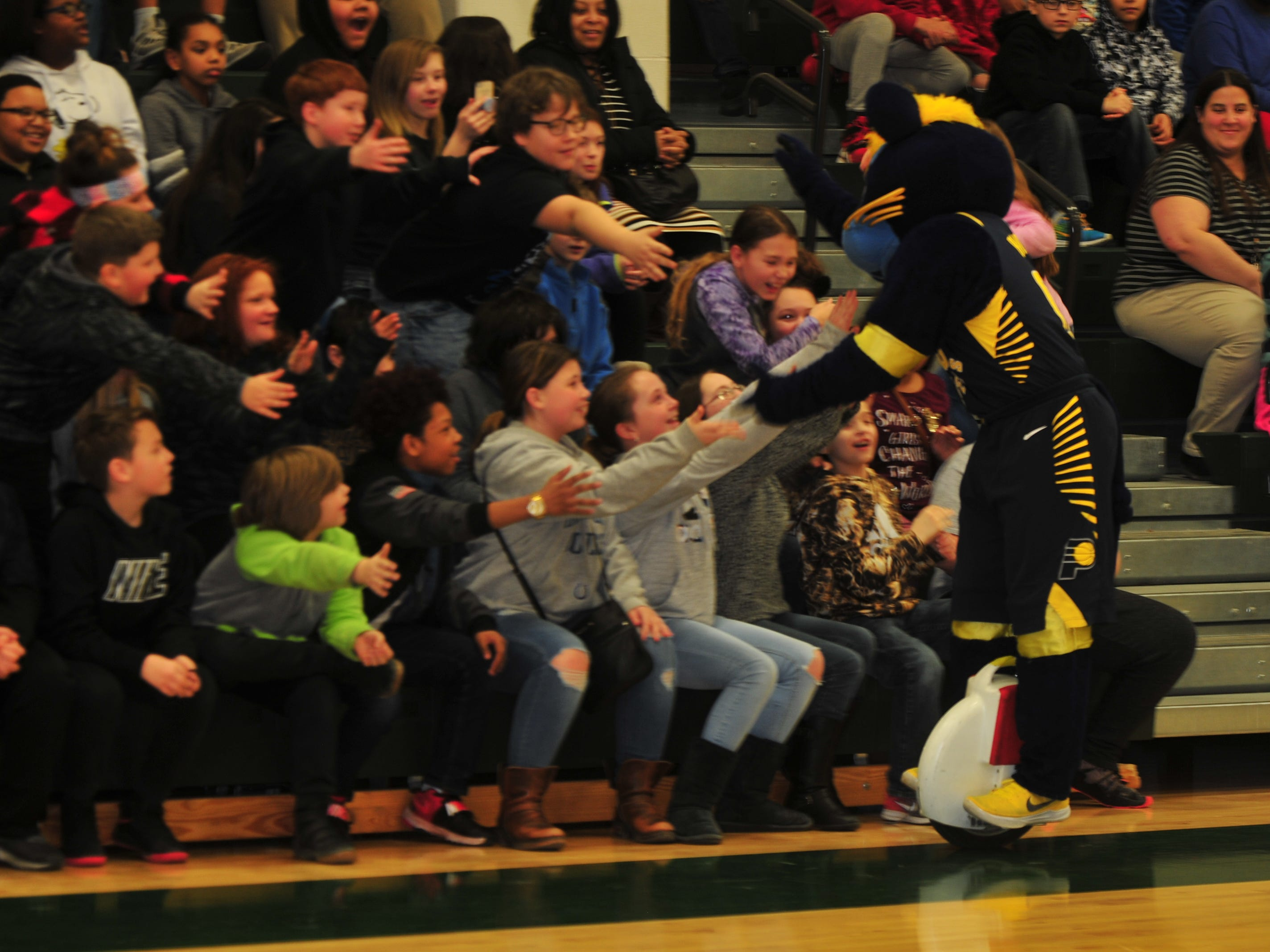 Dennis Intermediate School students greet Boomer, mascot for the NBA's Indiana Pacers, on Wednesday.