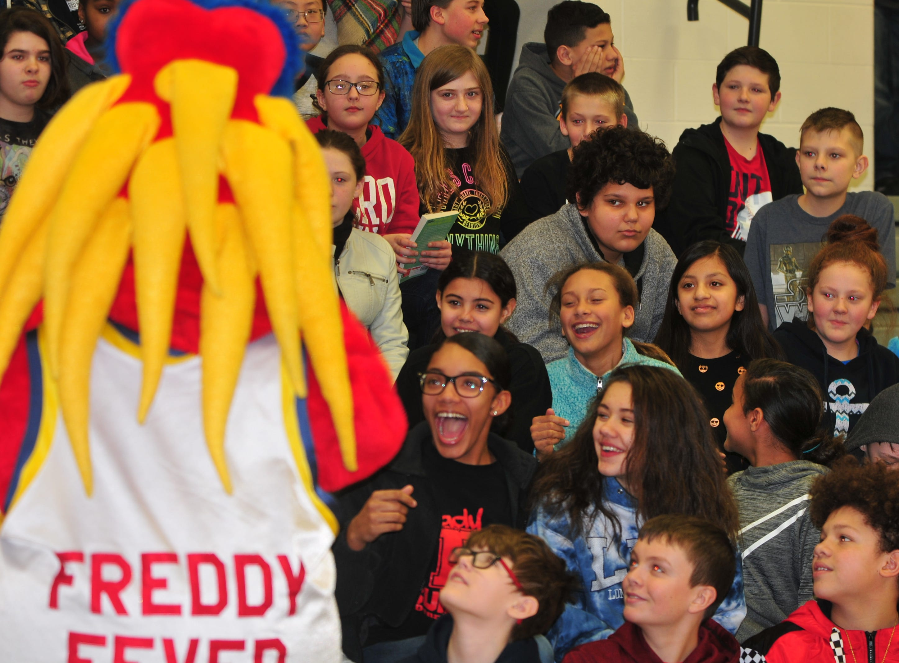Dennis Intermediate School students react to Freddy Fever, mascot for the WNBA's Indiana Fever.