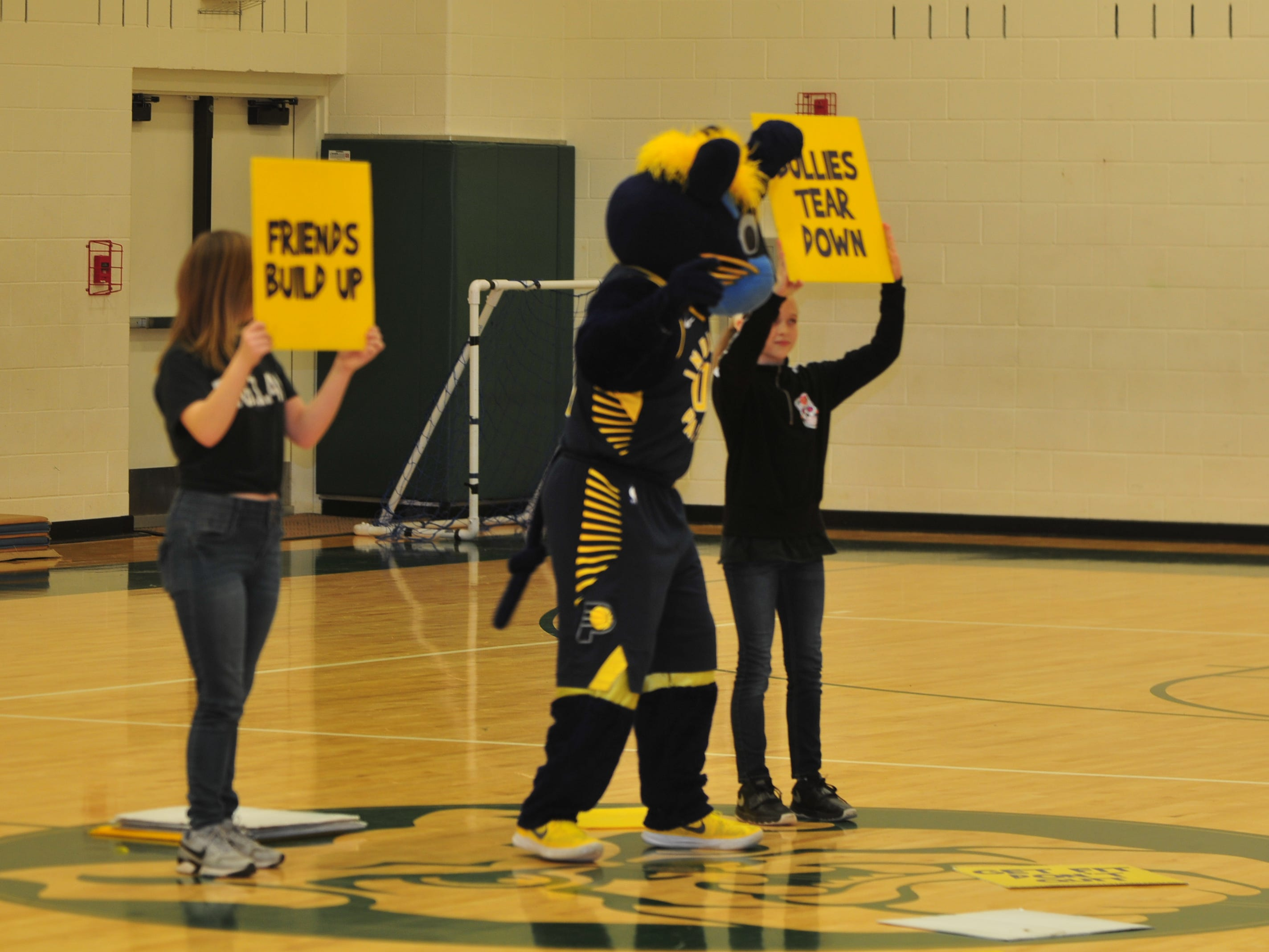 Boomer urges Dennis Intermediate School students to build each other up rather than bully each other during a Wednesday program.
