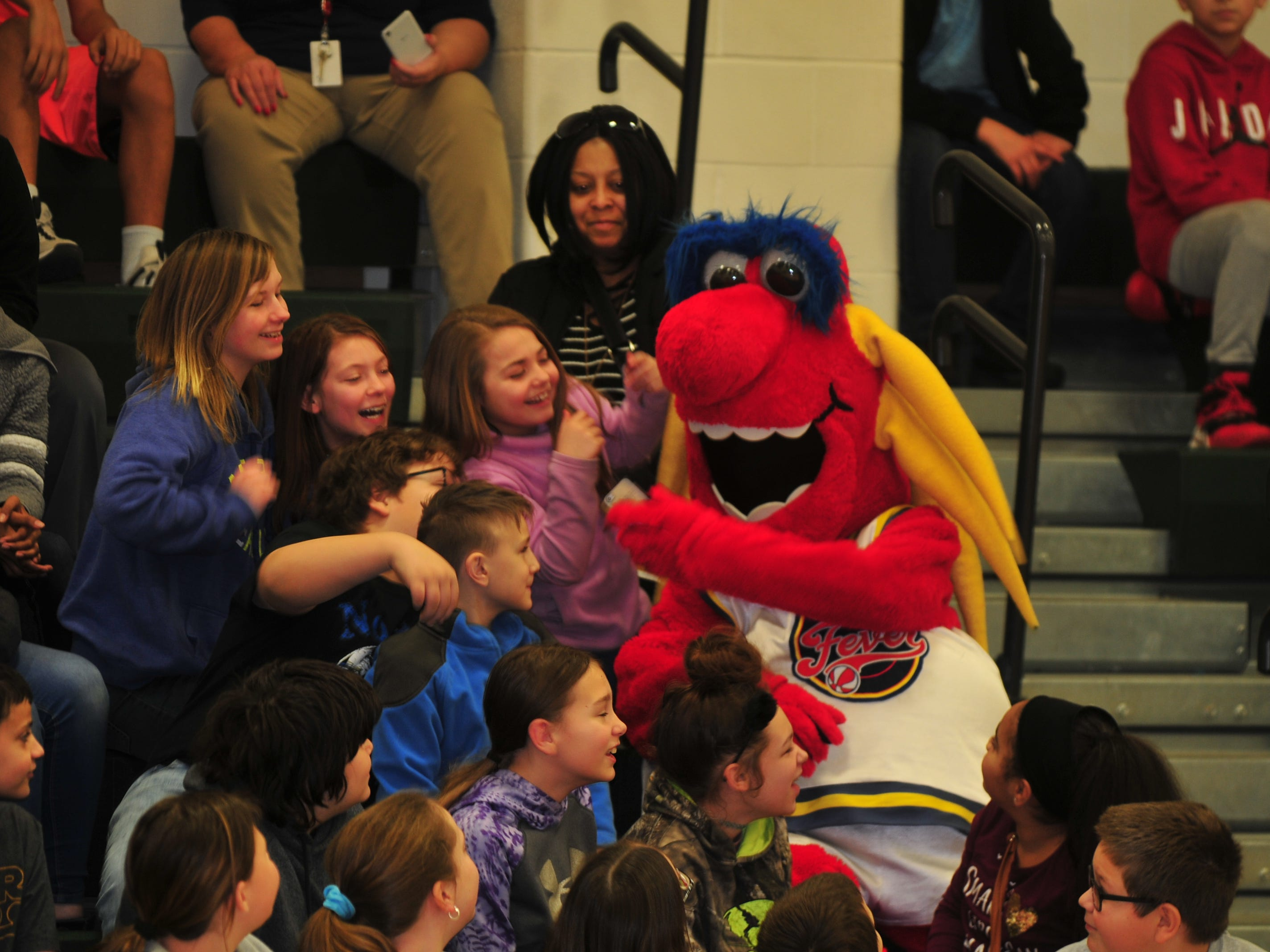 Freddy Fever, mascot for the WNBA's Indiana Fever, takes a selfie with Dennis Intermediate School students Wednesday.