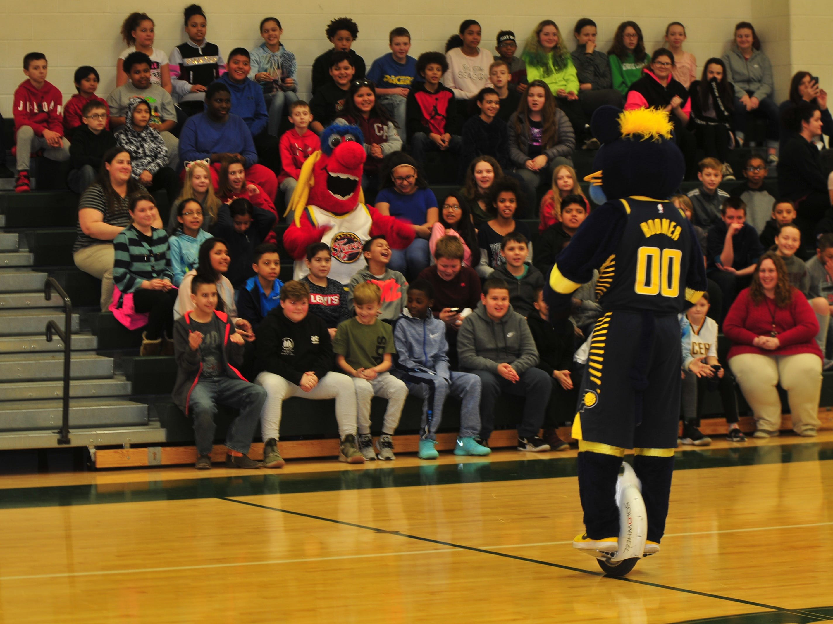 Boomer, mascot for the NBA's Indiana Pacers, starts his program Wednesday for Dennis Intermediate School students.