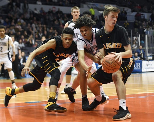 McQuaid's Harry Bruu, right, grabs a loose ball in front of teammate Jermaine Taggart, left, and Gates-Chili's Mitchell Harris during a Class AA sectional semifinal played at the Blue Cross Arena, Tuesday, Feb. 26, 2019. No. 3 seed McQuaid advanced to the Class AA final with a 82-75 win over No. 2 seed Gates-Chili.