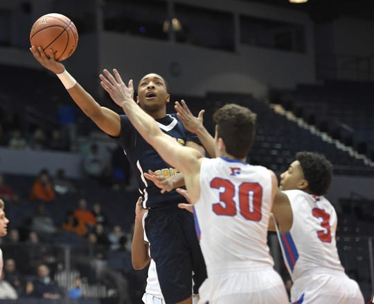 University Prep's Kayshawn Ross, left, drives to the basket past Fairport's Stefan Milinkovic (30) and Andre Starks during a Class AA sectional semifinal played at the Blue Cross Arena, Tuesday, Feb. 26, 2019. No. 8 seed University Prep advanced to the Class AA final with a 54-43 win over No. 4 seed Fairport.