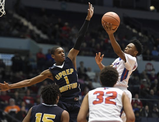 Fairport's Vanzell Johnson, right, drives to the hoop past University Prep's Na'Zea Fowlks during a Class AA sectional semifinal played at the Blue Cross Arena, Tuesday, Feb. 26, 2019. No. 8 seed University Prep advanced to the Class AA final with a 54-43 win over No. 4 seed Fairport.