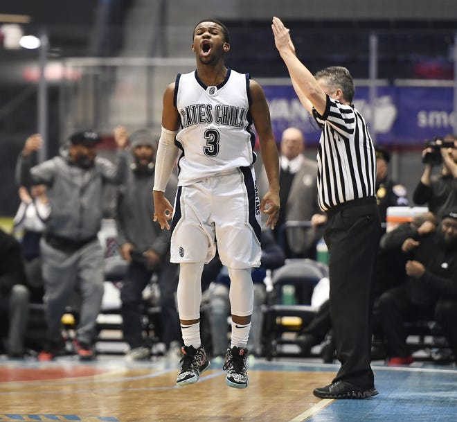 Gates-Chili's Keith Slack celebates one of his three point baskets during a Class AA sectional semifinal played at the Blue Cross Arena, Tuesday, Feb. 26, 2019. No. 3 seed McQuaid advanced to the Class AA final with a 82-75 win over No. 2 seed Gates-Chili.
