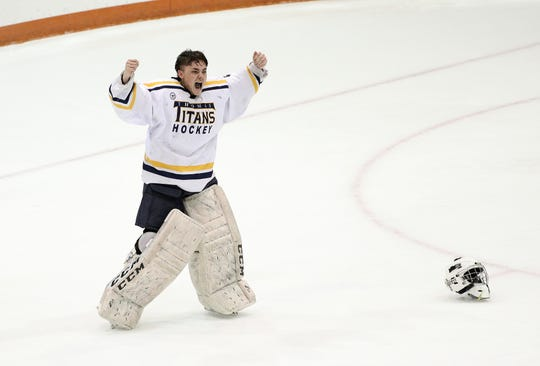 Thomas goalie Cody Rougeux celebrates Webster's 5-2 win over Spencerport in the Class B final.