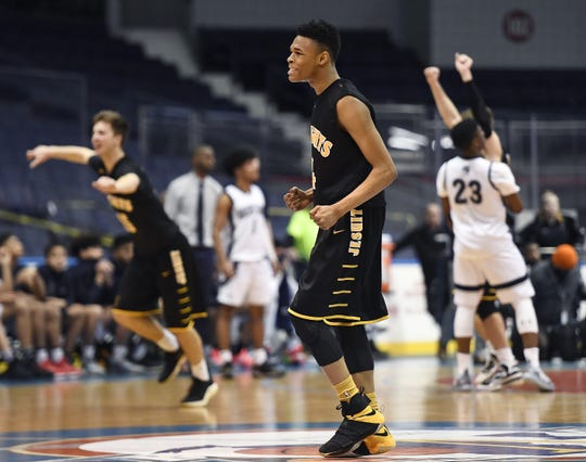 McQuaid's Jermaine Taggart celebrates at the final buzzer during a Class AA sectional semifinal played at the Blue Cross Arena, Tuesday, Feb. 26, 2019. No. 3 seed McQuaid advanced to the Class AA final with a 82-75 win over No. 2 seed Gates-Chili.