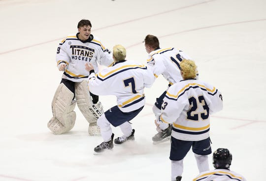 Thomas goalie goalie Cody Rougeux celebrates with teammates after winning the Class B title with a 5-2 win over Spencerport.