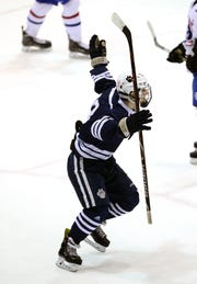 Pittsford's Brian Judge celebrates the Lgamewining goal in two overtimes to beat Fairport and win the Class A title.