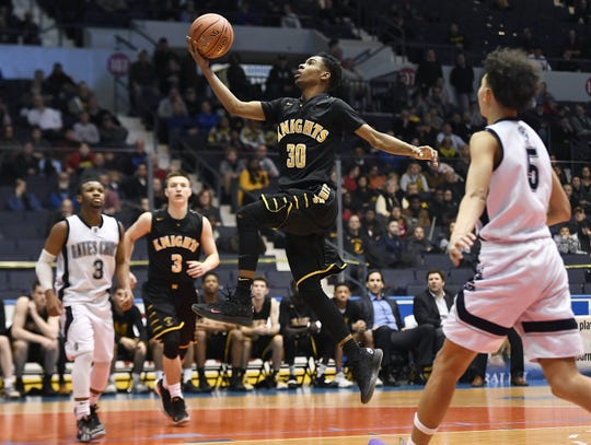 McQuaid's Kobe Long drives to the basket during a Class AA sectional semifinal played at the Blue Cross Arena, Tuesday, Feb. 26, 2019. No. 3 seed McQuaid advanced to the Class AA final with a 82-75 win over No. 2 seed Gates-Chili.