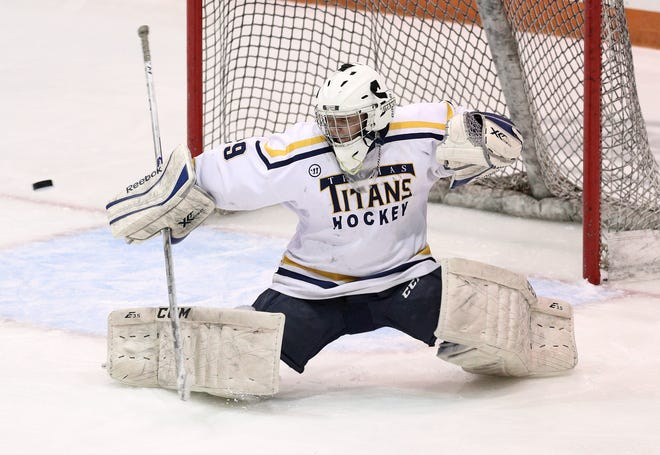 Thomas goalie Cody Rougeux makes a blocker save against Spencerport.