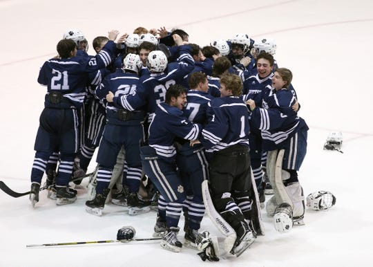 Pittsford celebrates winning the Class A title with a 3-2 win in two overtimes.