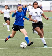 U-Prep senior Eila Chin takes a shot in front of Corning's Andrea Gonzalez during the Panthers' 4-1 win in the Division II Northern Section championship on Saturday, Feb. 23.