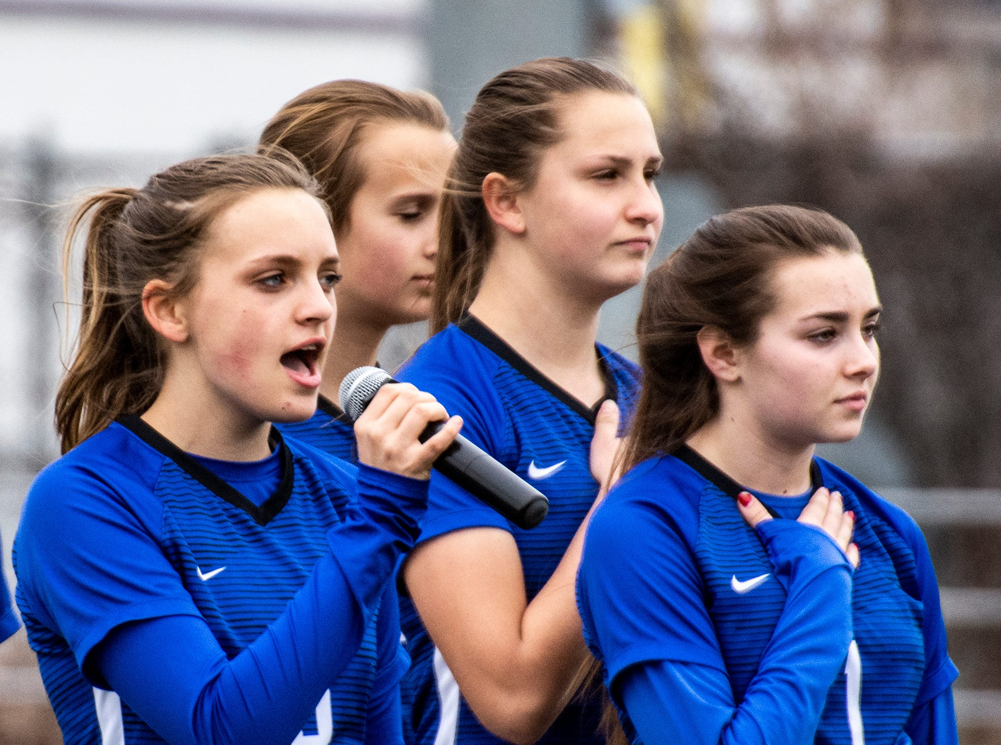 U-Prep's Sarah Richards sings the National Anthem before the Panthers' section championship game against Corning on Saturday, Feb. 23.