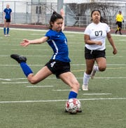 U-Prep's Savannah Leak takes a shot in front of Corning's Brisa Martinez during the Panthers' 4-1 win in the Division II Northern Section championship on Saturday, Feb. 23, 2019.